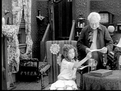 1913 b/w medium shot girl showing her grandfather letter in living room / usa  - 1913 stock videos & royalty-free footage