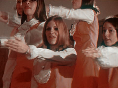 1970 medium shot girl singing in choir and performing choreographed hand movements - one teenage girl only stock videos & royalty-free footage