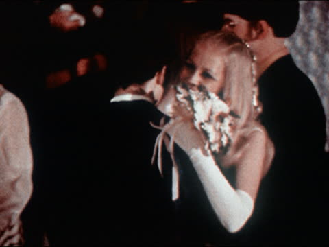 vidéos et rushes de 1970 medium shot girl smiling over shoulder of dance partner at prom / zoom out couples slow dancing on dance floor - slow