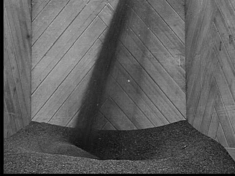 1909 b/w medium shot grain pouring into wooden container  - 1900 1909 stock-videos und b-roll-filmmaterial