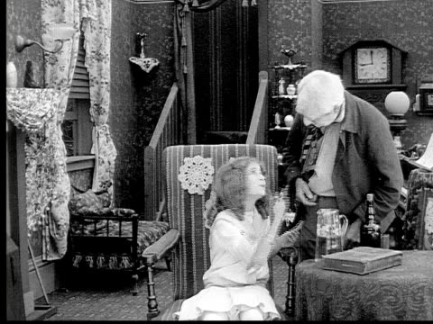 1913 b/w medium shot grandfather hugging and kissing grandfather in living room / usa  - 1913 stock videos & royalty-free footage
