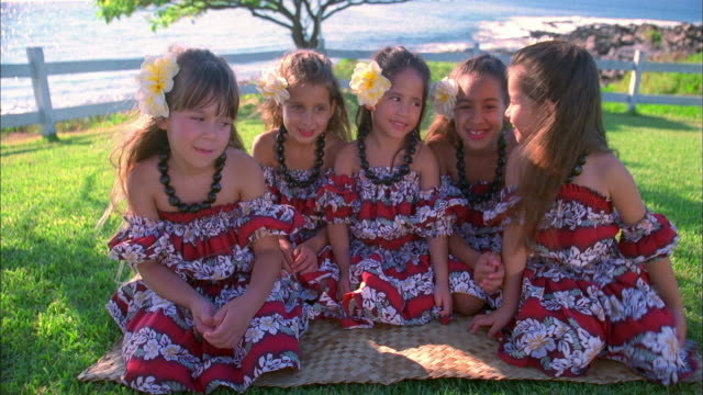 medium shot group of hawaiian girls in traditional dress - tradition stock videos & royalty-free footage