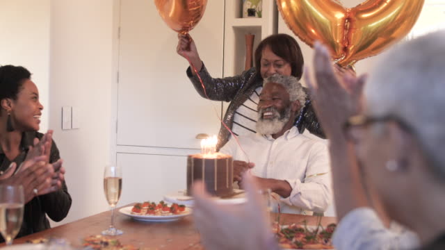 medium shot, happy african american man celebrates birthday - birthday candle stock videos & royalty-free footage