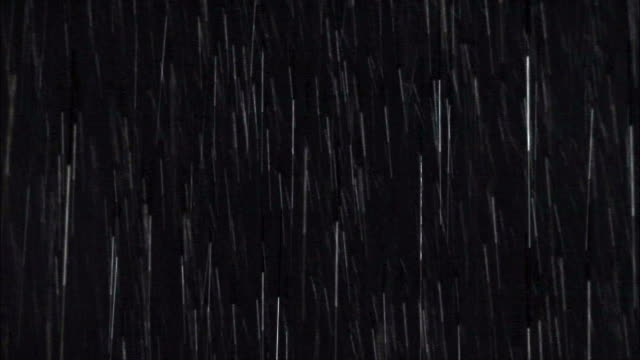 medium shot heavy rainfall against black background/ washington state - pioggia video stock e b–roll