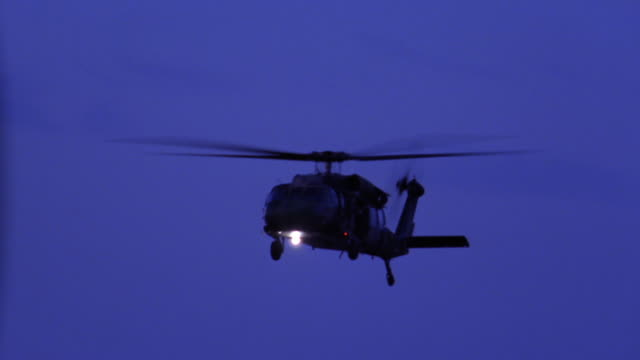 medium shot helicopter flying at twillight - military helicopter stock videos & royalty-free footage