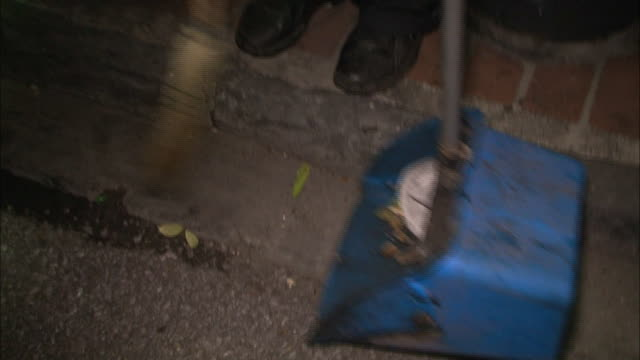 medium shot high angle zoom out - man sweeping trash on the street / new orleans louisiana - sweeping stock videos & royalty-free footage