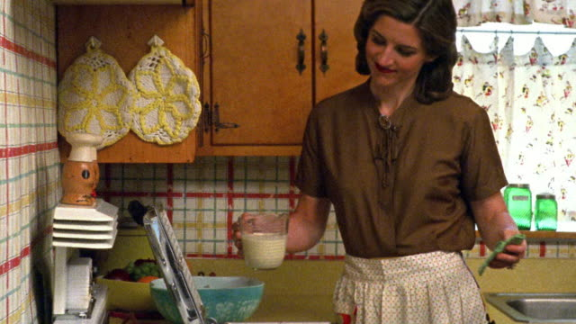 reenactment medium shot housewife approaching kitchen counter and pouring batter into waffle iron - waffle iron stock videos and b-roll footage