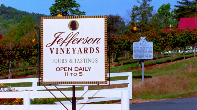 Medium shot Jefferson Vineyards sign with Colle historical sign in background/ Charlottesville, Virginia