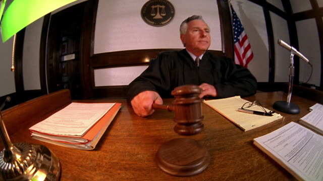 medium shot judge pounding gavel and calling for order - judge stock videos & royalty-free footage