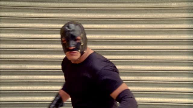 "medium shot luchador ""shadow"" turning to pose/ monterrey, mexico - elbow pad stock videos & royalty-free footage"