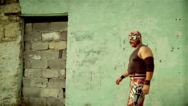 "medium shot luchador ""silver star"" walking on, looking at camera with hands on hips, and walking off/ monterrey, mexico - mexican culture stock videos & royalty-free footage"