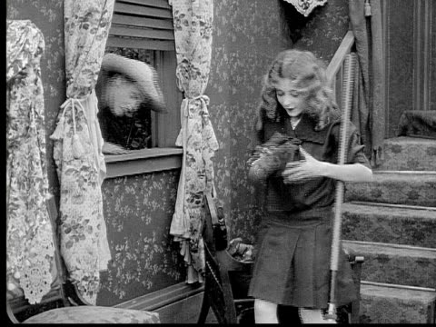 1913 B/W Medium shot Mailman delivering letter to girl through open window/ USA