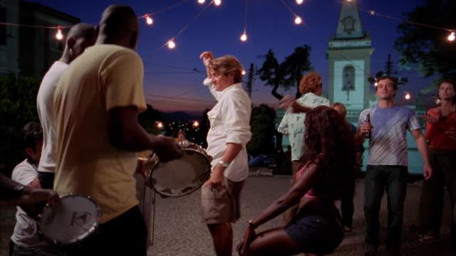 medium shot man and woman dancing to salsa + clapping / rio de janeiro - salsa stock videos & royalty-free footage