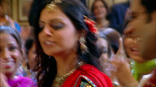 medium shot man and woman performing bollywood-style dance number - bollywood stock videos and b-roll footage