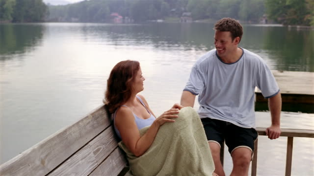 medium shot man and woman talking on dock - clarkesville stock videos & royalty-free footage