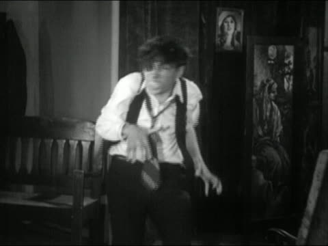 """b/w 1934 medium shot man (ted edwards) changing into mr. hyde-type character / """"maniac"""" / audio - 1934 stock videos & royalty-free footage"""