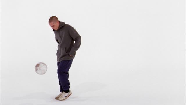 medium shot man dribbling clear soccer ball - sportswear stock videos & royalty-free footage