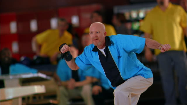 medium shot man in team jersey bowling / kneeling and holding his head - failure stock videos & royalty-free footage