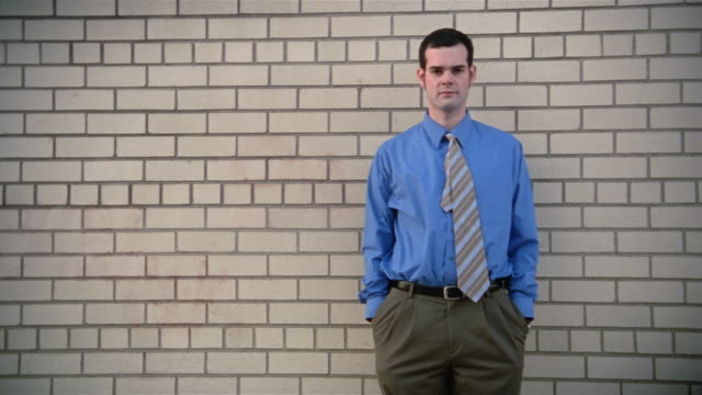 medium shot man in tie standing in front of brick wall - sideburn stock videos & royalty-free footage