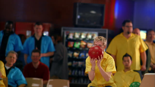 medium shot man in yellow team jersey bowling / looking anxious and cheering - bowl stock videos & royalty-free footage