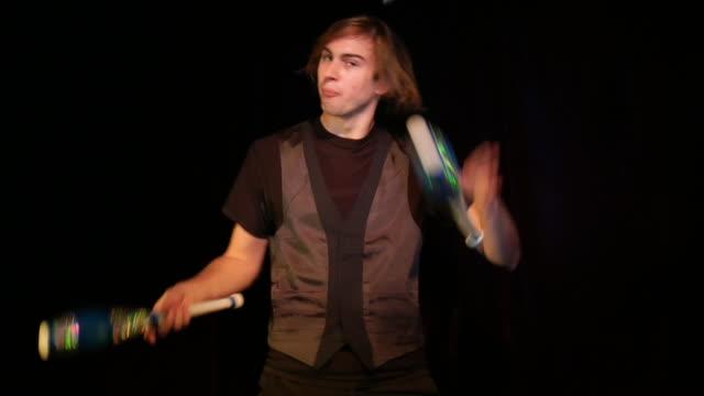 Medium shot man juggling
