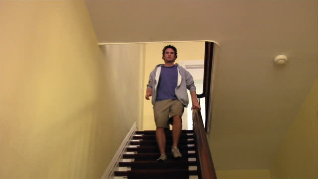 Medium shot man running down stairs/ Roxbury, New York