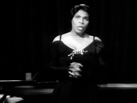 medium shot marian anderson singing onstage next to grand piano during performance/ usa - 1951年点の映像素材/bロール