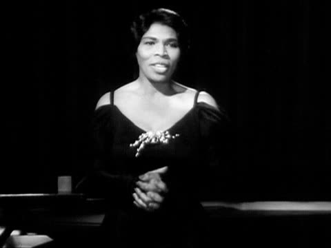 medium shot marian anderson singing onstage next to grand piano during performance/ usa - formal glove stock videos and b-roll footage