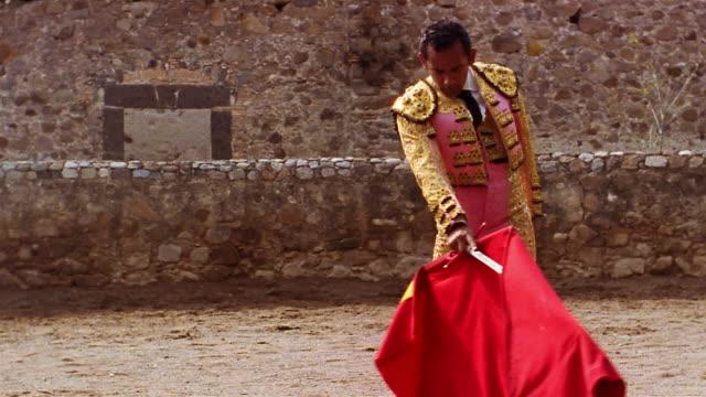 medium shot matador twirling his cape and sword around - bullfighter stock videos & royalty-free footage