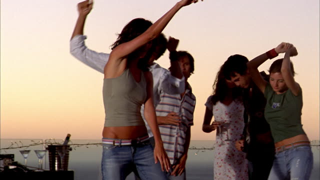 stockvideo's en b-roll-footage met medium shot men and women dancing - 2003