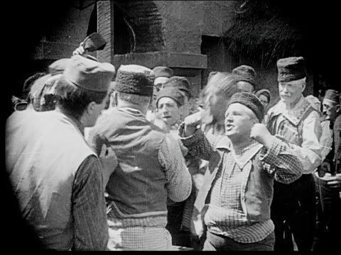 1916 b/w medium shot men in town square debating passionately - debate stock videos & royalty-free footage