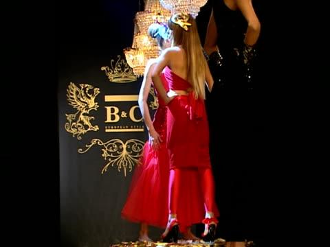 medium shot models turning on catwalk stage during b&c european style fashion show rehearsal/ belgrade, serbia  - strapless stock videos & royalty-free footage