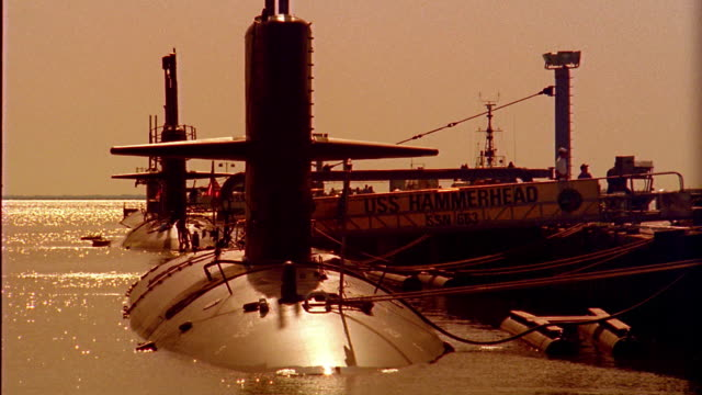 Medium shot Naval submarines docked in harbor / Norfolk, Virginia