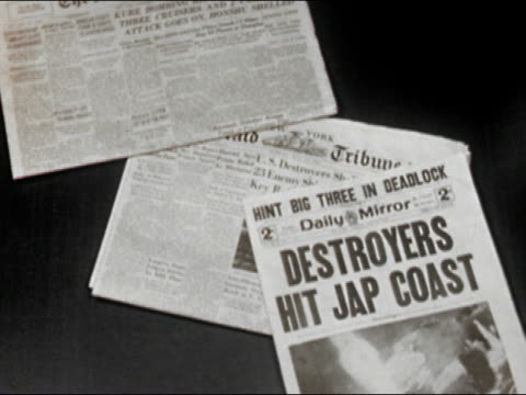 vidéos et rushes de medium shot new york newspapers with wwii headlines landing on table one by one/ audio - prelinger archive