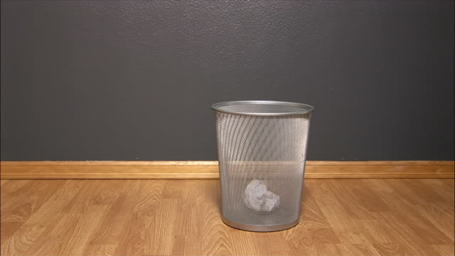 medium shot nine paper balls being thrown toward waste basket with two going in/ washington state - lanciare video stock e b–roll