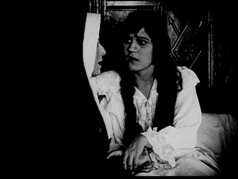1916 b/w medium shot nun consoling weeping young woman in bed - 1916 stock videos & royalty-free footage
