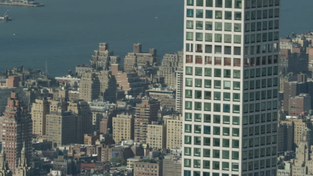 Medium shot of 432 Park Avenue with New York cityscape