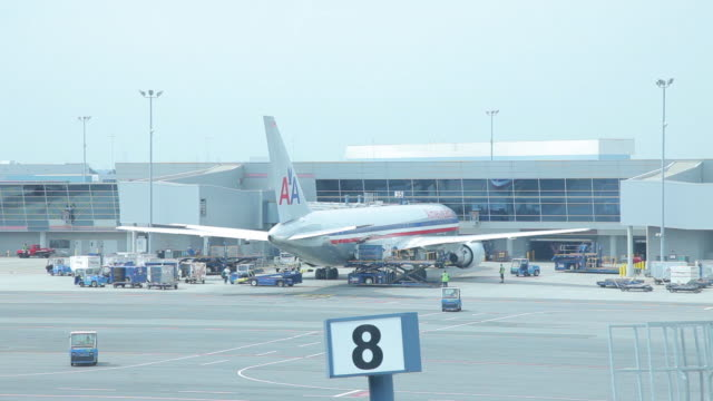 Medium Shot of a American Airlines aircraft docked at the gate, Laguardia Airport