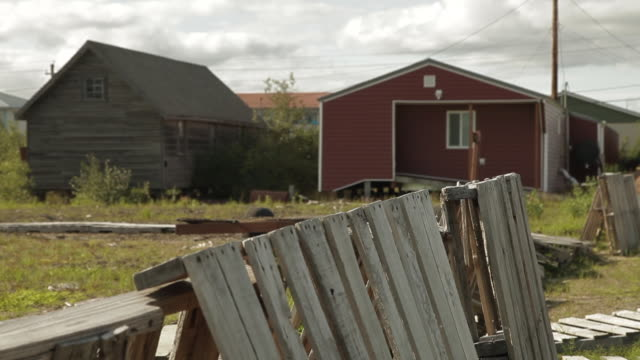 medium shot of a broken down fence in front of houses - fence stock videos and b-roll footage