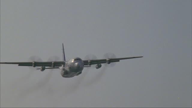 medium shot of a cargo plane flying across the sky. - cargo aeroplane stock videos & royalty-free footage