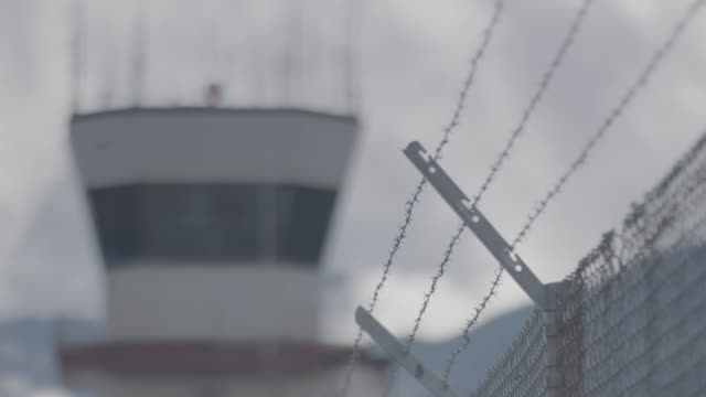 medium shot of a control tower at juneau international airport - chainlink fence stock videos and b-roll footage
