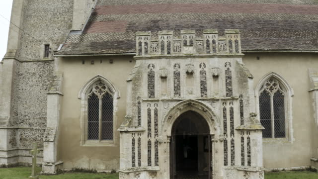 medium shot of a drone moving along the south side of the church of st mary in troston - veranda stock videos & royalty-free footage