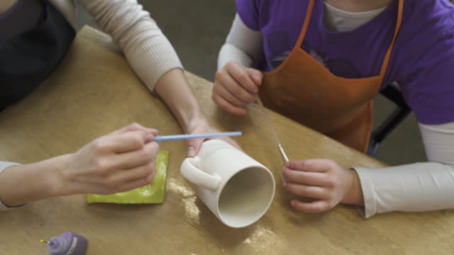 medium shot of a family in a ceramic studio - diy stock videos & royalty-free footage
