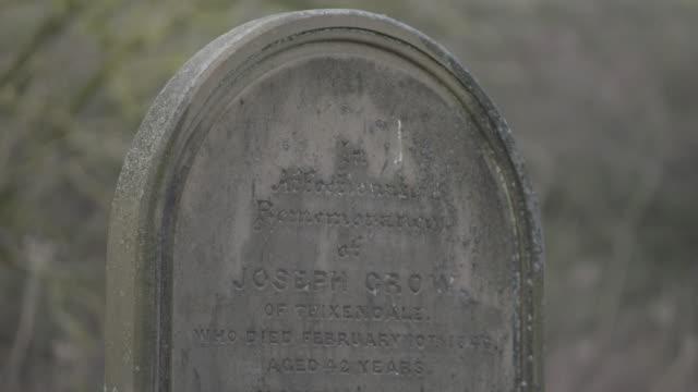 medium shot of a gravestone near st martins church in wharram percy - tomb stock videos & royalty-free footage