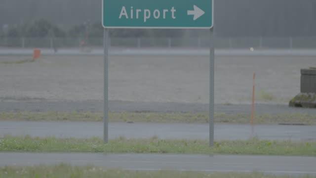 medium shot of a juneau airport traffic sign - juneau stock videos and b-roll footage