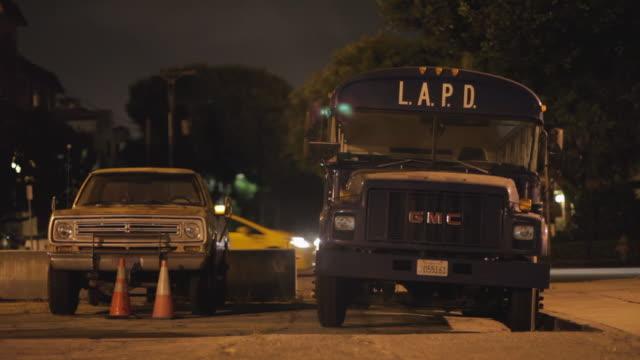 medium shot of a lapd bus parked in los angeles night - 緊急用具点の映像素材/bロール