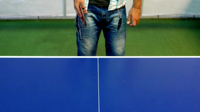 medium shot of a man who is hitting a ball in table tennis game - table tennis bat stock videos & royalty-free footage