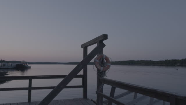 Medium shot of a pier in Boothbay Harbor early in the evening