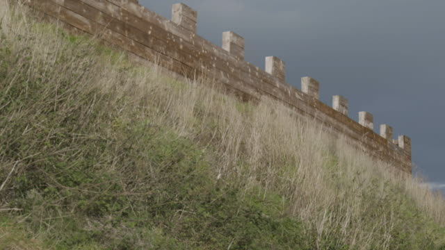 medium shot of a reconstructed wooden wall at the vindolanda roman fort - uncultivated stock videos & royalty-free footage