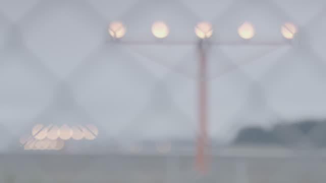 Medium shot of a runway of Juneau International Airport behind a fence